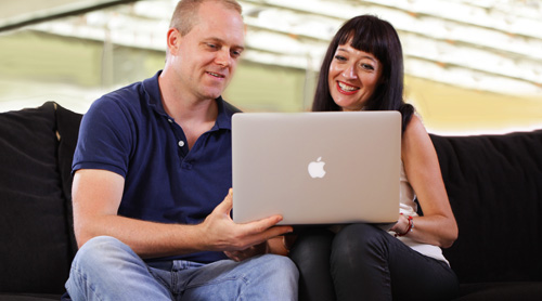 Couple holding a computer