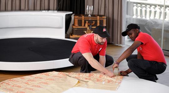 Men wrapping furniture