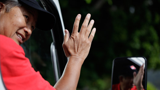 Truck driver greeting with his hand