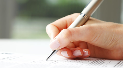 Signing a moving insurance form.